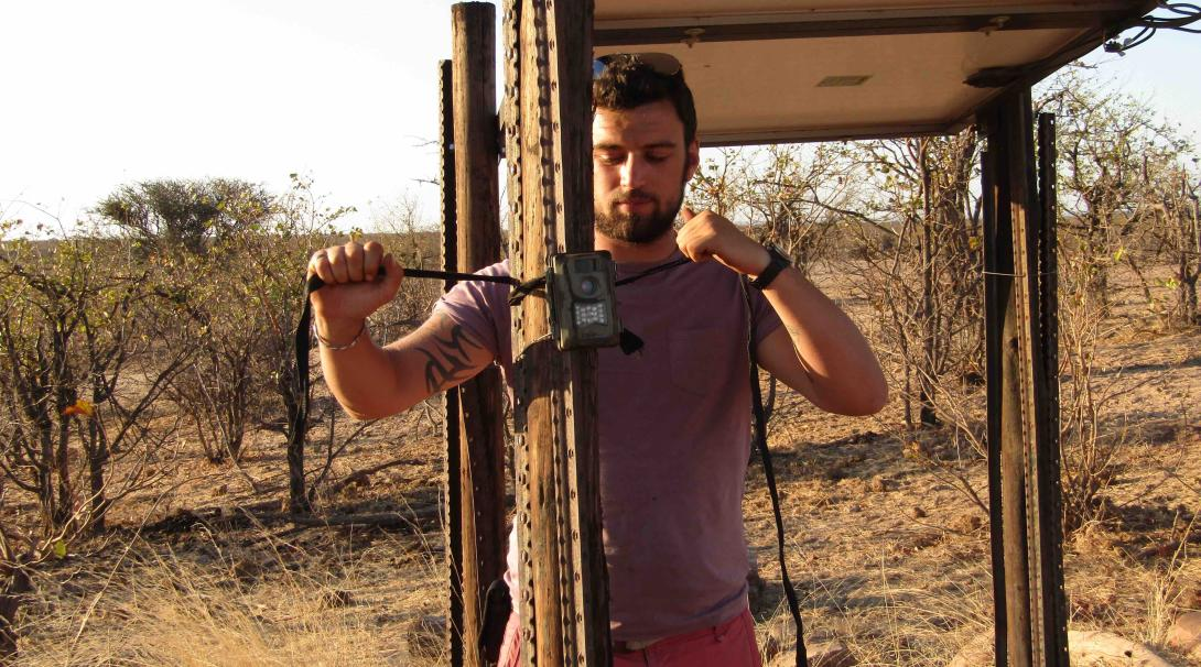 A Projects Abroad conservation volunteer sets up a survey camera in Botswana.